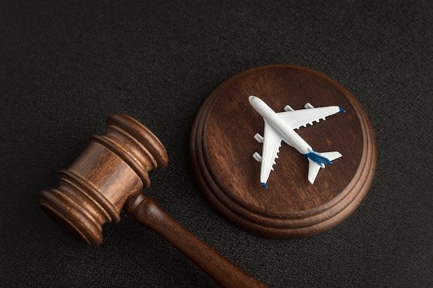 Wooden judges gavel and toy plane