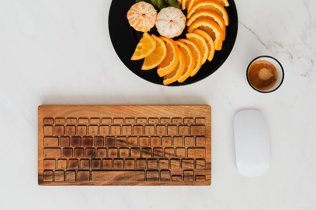 Wooden keyboard with a fruit plate