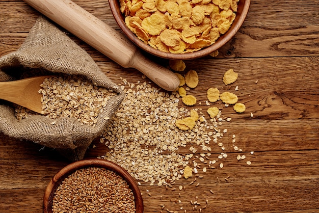 Wooden kitchen items cereals products view from above