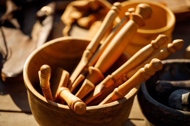 Wooden kitchen spatulas in a wooden plate on the table
