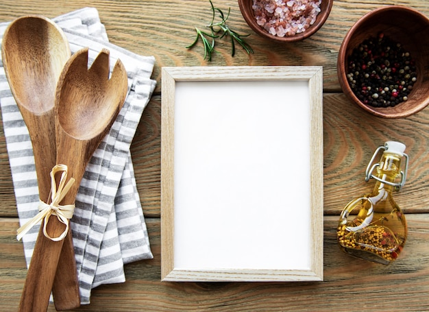 Wooden kitchen utensils and spices with wooden frame