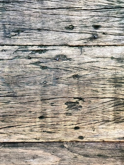 Wooden knotted wall with nails as the background texture
