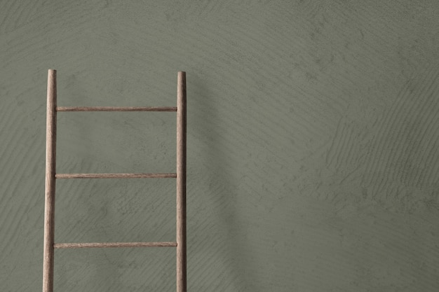 Wooden ladder leaning against a concrete wall