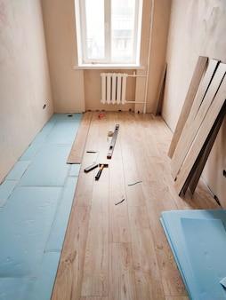 Wooden laminate floor installation process in flat apartment