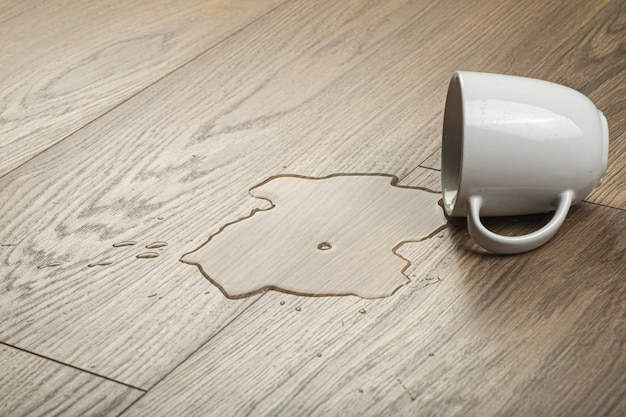 Wooden laminate and parquet board with spilled water