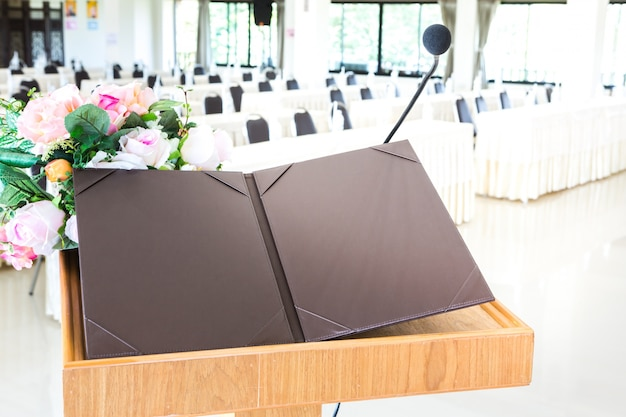 Wooden lectern with black folder