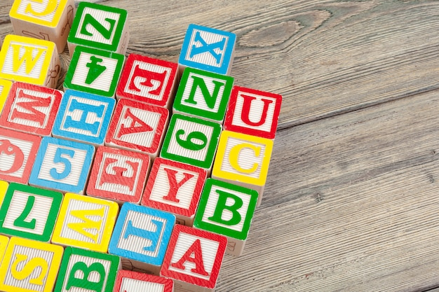 Wooden letter cubes with letters on wooden table