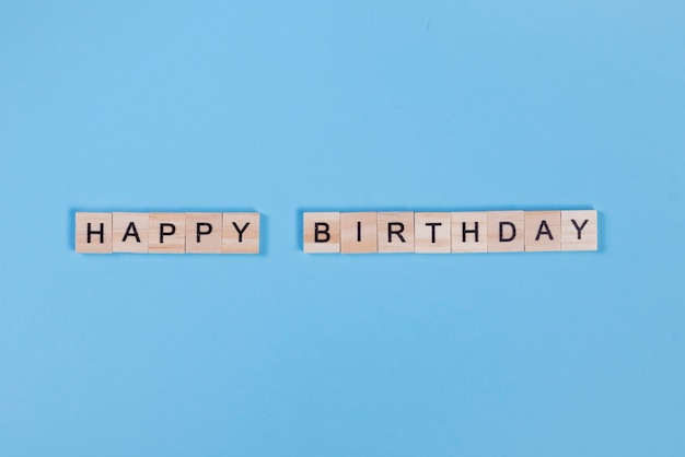 Wooden letters arranged in happy birthday