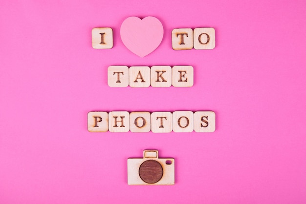 Wooden letters, inscription on a bright pink background. international day of photography