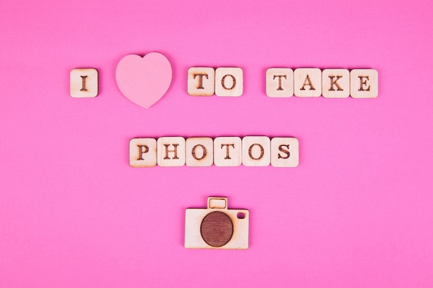 Wooden letters, inscription on a bright pink background