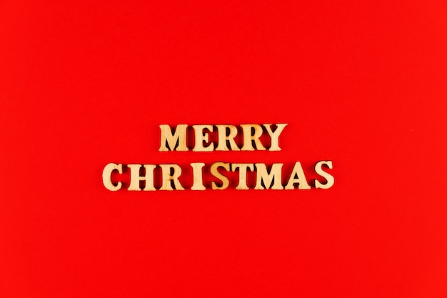 Wooden letters. merry christmas lettering in red paper. copy space.