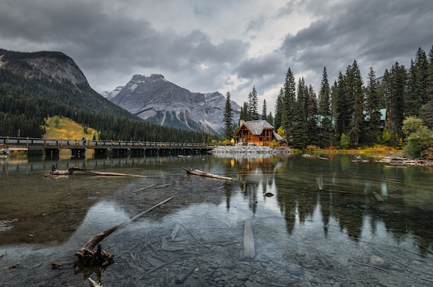 Wooden lodge on emerald lake with rocky mountains at yoho national park