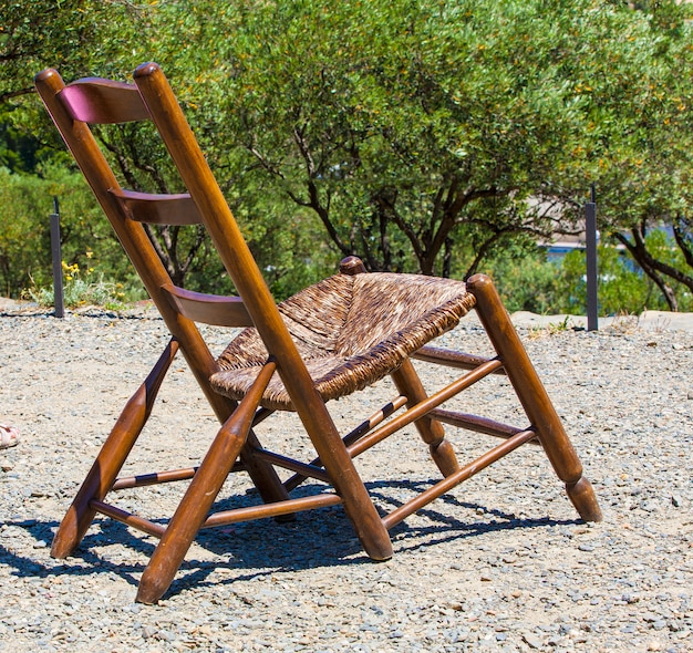 Wooden lounge chair in the garden