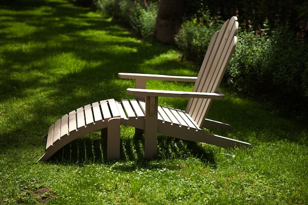 Wooden lounger lying on the grass a bed on green grass