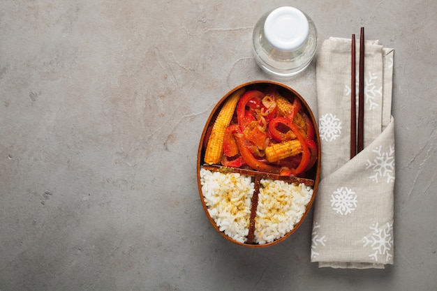 Wooden lunch box with healthy food.