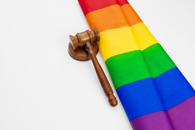 Wooden  mallet and lgbt rainbow flag isolated