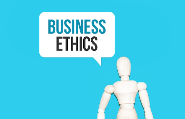 The wooden man and white cloud with text business ethics.