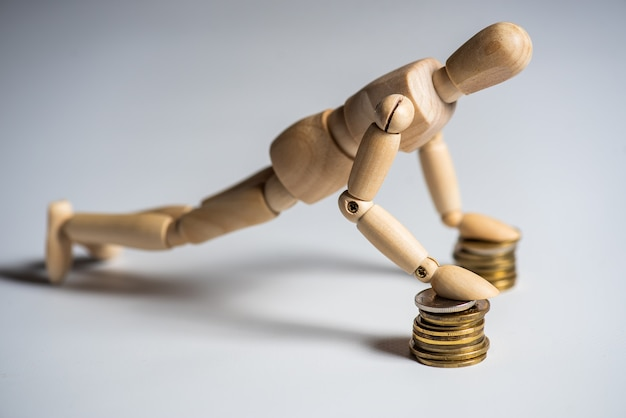 Wooden man with coins