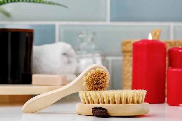 Wooden massage body brush in the bathroom
