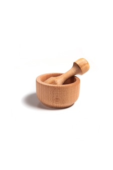 Wooden mortar with pestle isolated on a white background