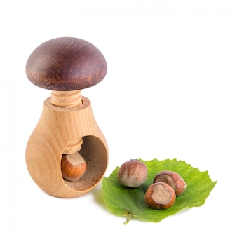 Wooden mushroom shape nutcracker and hazelnuts