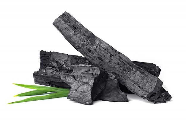 Wooden natural charcoal with pandan leaf isolated on white surface