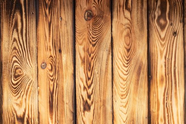 木製の自然な、織り目加工の、焦げた、ボードが隣り合って積み重ねられている、背景。テキストの場所。