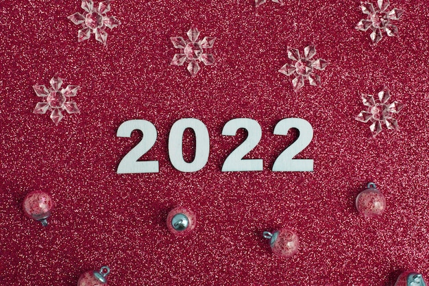 Wooden numbers new year  with christmas decor on glitter red background