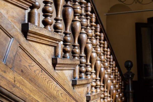 Wooden old decorative balusters, ancient wooden stairs. decorative railings carved from wood