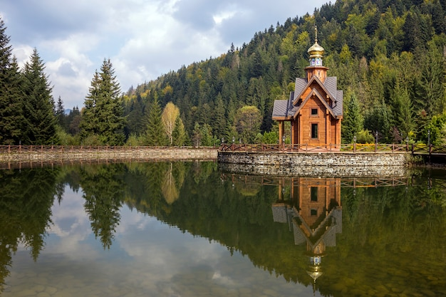 Wooden orthodox chapel in ecological area on small artificial island