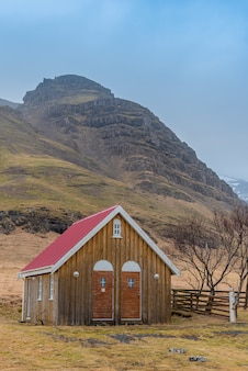 Wooden outhouse for the historic kalfafellsstadur church in iceland