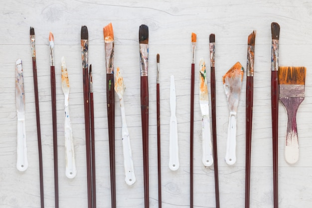 Wooden paint brushes and knives for art