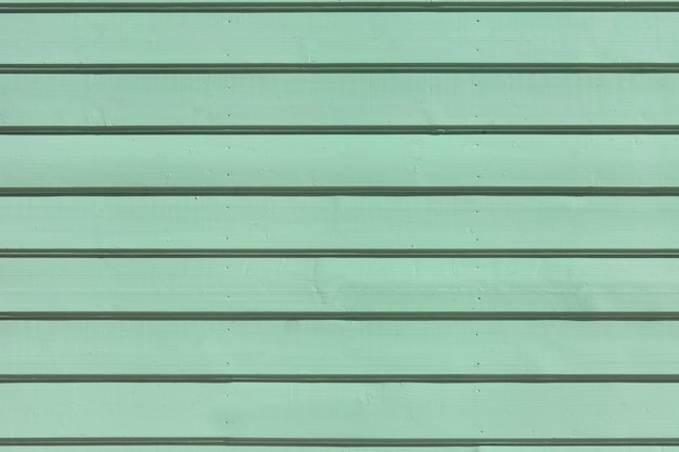 나무 페인트 판자 표면입니다. 배경 또는 벽지에 대한 녹색 청록색 목재 벽 질감