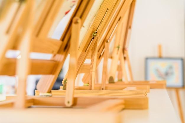 Wooden painter easels in an art class.