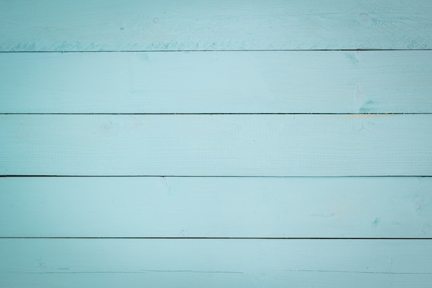 Wooden painting with aqua pastel color as background