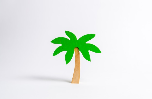Wooden palm tree on a white background