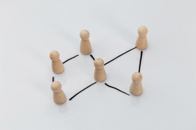 Wooden people on a white table, business concept, human resources and management concept.