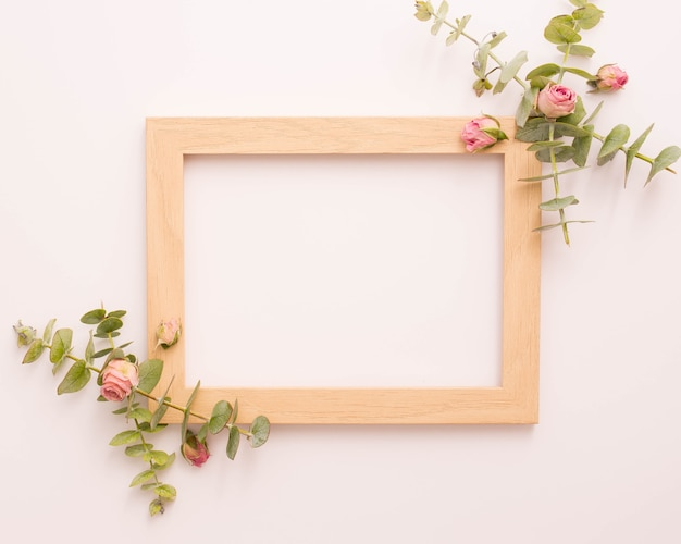 Wooden picture frame decorated with pink roses and eucalyptus