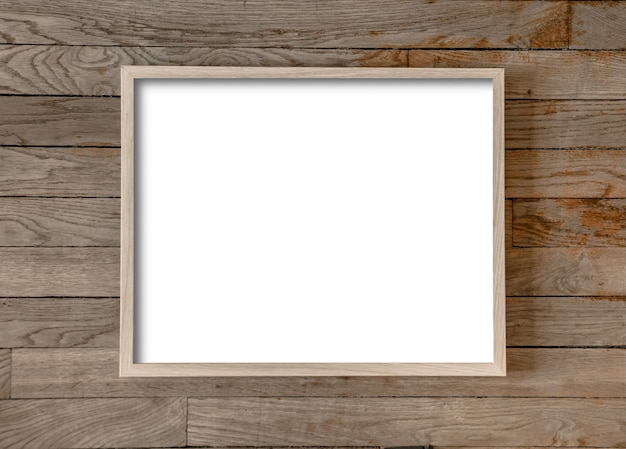 Wooden picture frame hanging on old wooden wall surface