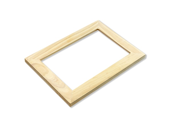 Wooden picture frame hanging on a white wall.  perspective view