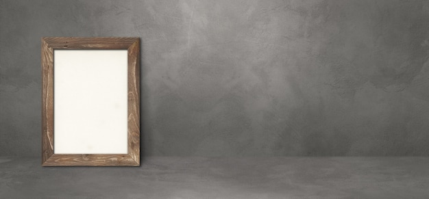 灰色の壁に寄りかかって木製の額縁。空白のモックアップテンプレート。横バナー