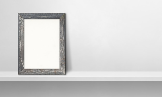 Wooden picture frame leaning on a white shelf. 3d illustration. blank mockup template. horizontal banner