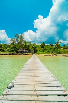 Wooden pier or bridge with tropical beach