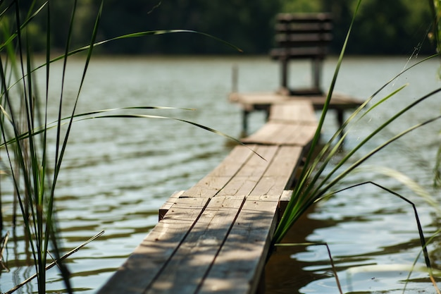 Wooden pier on the lake in village.