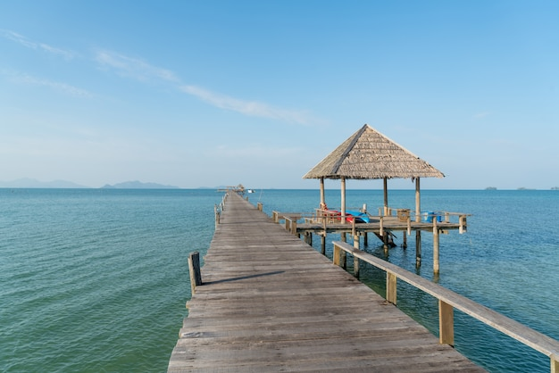 Wooden pier with boat in phuket, thailand. summer, travel, vacation and holiday concept.