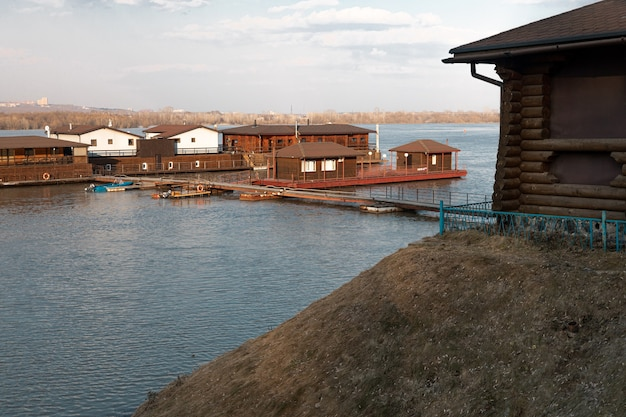 Wooden pier with old houses over blue water