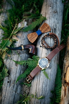 Wooden pipe, bow tie and bracelets lie over the blocks