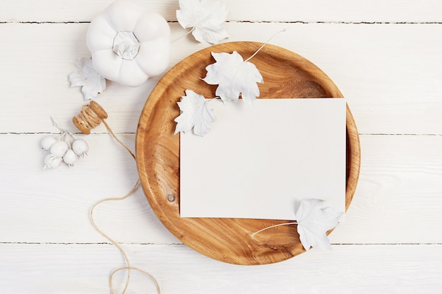 Wooden place with white sheet of paper