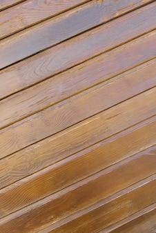木の板の背景傾斜クルミ色