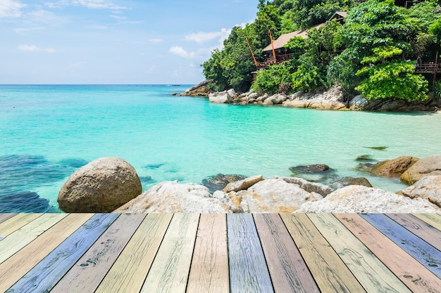 Wooden plank colorful with crystal sea and resort
